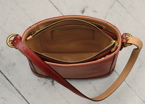 Hand-grained,-hand-colored-berbere-red-Shoulder-Bag-with-natural-trim-and-short-strap;-10-x-10-x-3'-topdown3