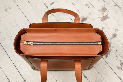 Hand-burnished-chestnut-City-Tote-with-long-flat-handles-and-tangerine-grosgrain-lining;-16-x-12-x-7'-topdown1
