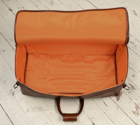 Hand-burnished-espresso-Square-Duffel-with-open-front-pocket-and-tangerine-lining;-22-x-12-x-8'-topdown3