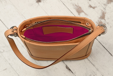 Hand-burnished-natural-leather-Shoulder-Bag-with-short-shoulder-strap-and-magenta-lining;-10-x-10-x-3'-topdown3
