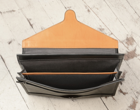 Hand-burnished-black-Letter-Size-Flapover-Folderholder-with-warm-gray-lining-and-natural-leather-trim-topdown2